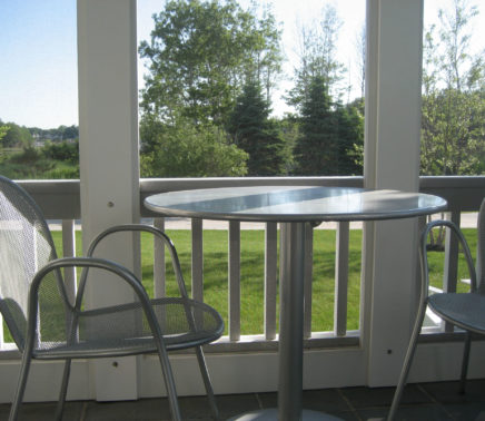 11. a bistro table on the screened porch