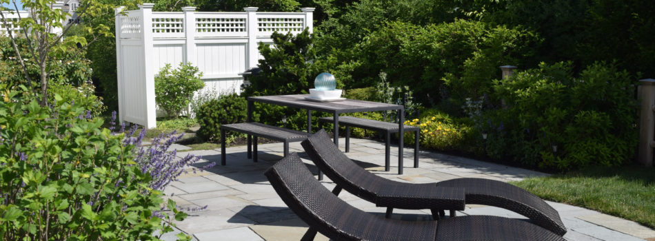 14. the rear terrace with table, benches and chaise lounge chairs